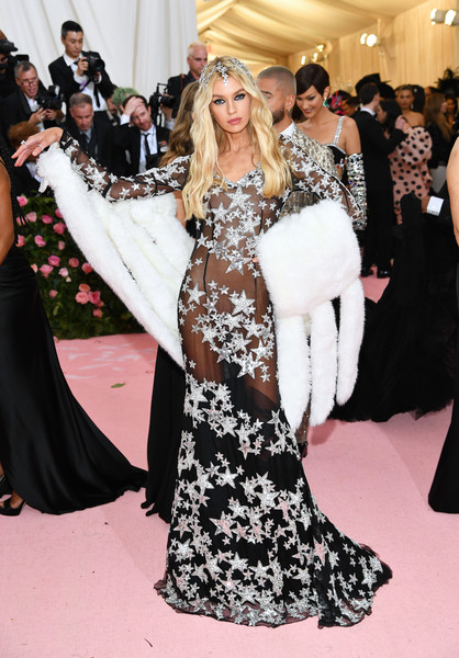 Stella Maxwell Sheer Dress [red carpet,clothing,carpet,fashion,flooring,dress,event,gown,haute couture,fashion model,fashion - arrivals,stella maxwell,notes,fashion,new york city,metropolitan museum of art,met gala celebrating camp]