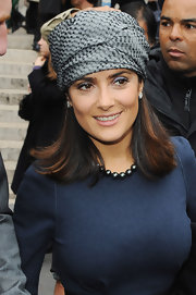 Salma showed off her head wrap while hitting  Paris Fashion Week.