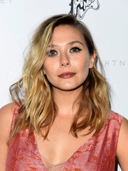 Elizabeth Olsen attended the Stella McCartney presentation rocking a messy wavy 'do.