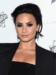 Demi Lovato looked cool with her mildly messy, slicked-back 'do at the Stella McCartney presentation.