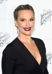 Molly Sims looked charming with her double French braids at the Stella McCartney presentation.