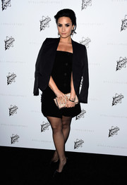 Demi Lovato was decked out in all black with a strapless dress, blazer, and sheer tights to complete her look.