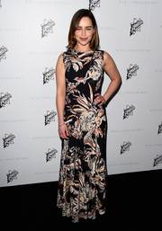 Emilia Clark looked sophisticated in her bold floral gown while attending the Stella McCartney presentation.