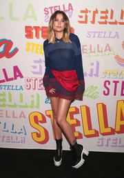 Paris Jackson styled her hoodie with chunky platform boots, also by Stella McCartney.
