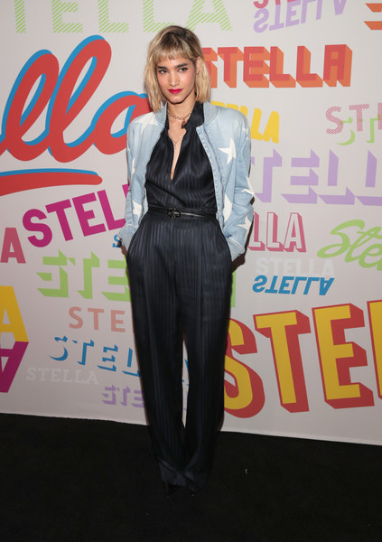 Sofia Boutella looked sharp in a pinstriped satin jumpsuit by Stella McCartney during the brand's Autumn 2018 collection launch.