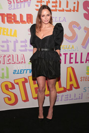 Stella McCartney channeled the '80s with this puff-sleeved peplum LBD during her brand's Autumn 2018 collection launch.