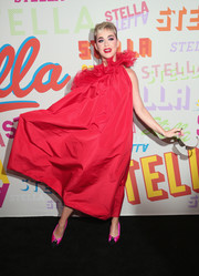 Katy Perry was her usual flamboyant self in a voluminous red one-shoulder gown with a ruffled neckline at the Stella McCartney Autumn 2018 collection launch.