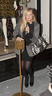 Emma Bunton paired her gray tuxedo-inspired blazer with black patent leather platform pumps.