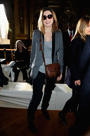 Julie Gayet showed off her classic style with this tan leather bag.