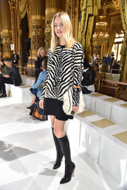 Natalia Vodianova punched up her look with a pair of enamel-heeled knee-high boots by Givenchy.
