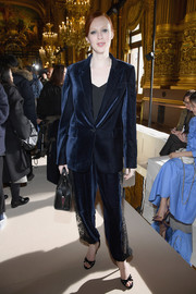 Karen Elson went menswear-chic in a loose navy velvet suit with lace panels down the trouser sides for the Stella MacCartney Fall 2018 show.