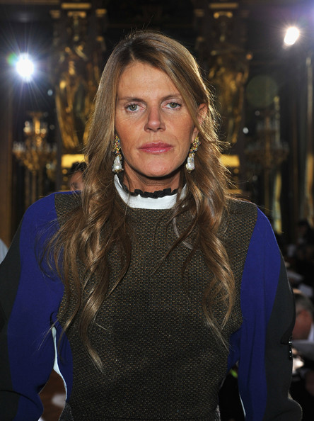 Anna dello Russo was all dolled up with pearl and gemstone drop earrings and lovely waves during the Stella McCartney fashion show.