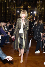 Anna Wintour looked every inch the fashion queen in a gold and black brocade coat during the Stella McCartney fashion show.