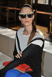 Elettra Wiedemann went for a sporty vibe in a black-and-white crewneck sweater when she attended the Stella McCartney fashion show.