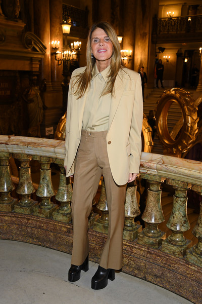 Anna dello Russo looked uncharacteristically low-key in a neutral-toned suit by Stella McCartney during the brand's Fall 2019 show.