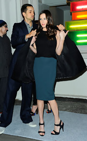 Liv Tyler wore a two-tone cocktail dress with a delicate peplum to the Stella McCartney store opening.
