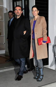 Mary McCartney carried a fire engine red clutch. She paired the festive purse with a camel coat and gray jeans.