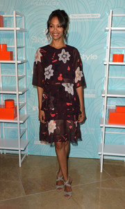 Zoe Saldana chose a pair of gray Jimmy Choo Xenia sandals to team with her cute dress.