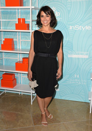 Constance Zimmer chose on-trend white slim-strap sandals to complement her dress.