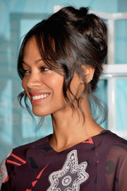 Zoe Saldana pulled her locks up into a romantic messy updo for the Inspiration Awards.
