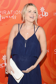 Ali Fedotowsky attended the Inspiration Awards carrying a classic white leather clutch.