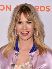 January Jones matched her jacket with a pair of pink lucite hoops.