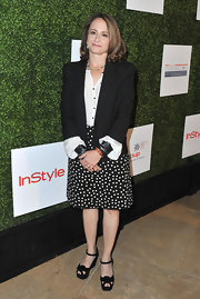 To keep her look classic and sophisticated, Nina Jacobson chose a black blazer.