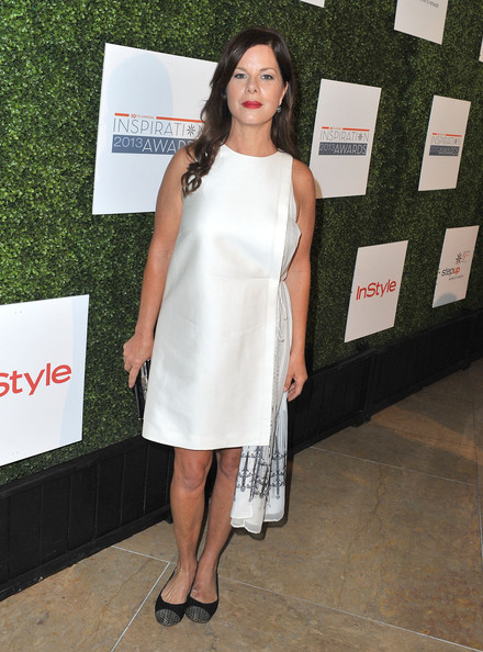 Marcia Gay Harden's white frock featured a cool asymmetrical hem and embroidered mesh sash on the side.