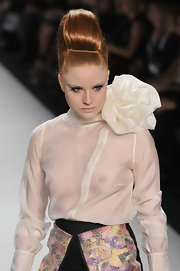 Barbara Meier walked the Stephan Pelger Show of Berlin's Fashion Week in a dramatic modified beehive hairdo.