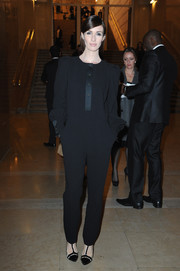 Paz Vega donned a conservative black jumpsuit for the Stephane Rolland fashion show.