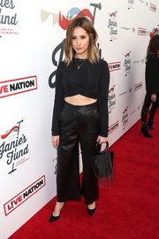 Ashley Tisdale styled her outfit with a fringed chainmail purse by Whiting & Davis.