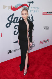 Black mesh pumps with silver toe caps sealed off Sydney Sweeney's look.