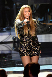 Beyonce Knowles electrified the crowd wearing a super-short sequined dress by Michael Costello during the Stevie Wonder Grammy Salute show.
