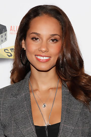 Alicia Keys' gorgeous glossy hair was the only accessory she needed at the photocall for 'Stick Fly'.