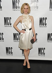 Sarah Paulson looked divine in classic black pumps. The heels matched the belt of her white silk cocktail dress.