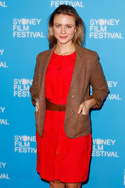 Maeve Dermody looked conservative at the 'Stoker' premiere in a brown tweed jacket layered over a simple red dress.