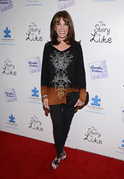 Kate Linder paired her oversized tunic with a pair of basic black leggings.