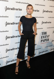 Hailey Baldwin showed off her enviable figure in a black Stradivarius bodysuit during the launch of the Event Paper.