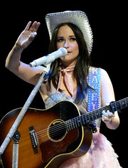 Kacey Musgraves teamed a rhinestone-embellished cowboy hot with a sparkling strapless dress for her performance at the 'Strait to Vegas' show.