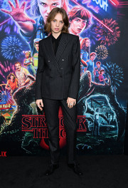 Maya Hawke went androgynous-chic in a pinstriped pantsuit by Saint Laurent at the New York screening of 'Stranger Things' season 3.