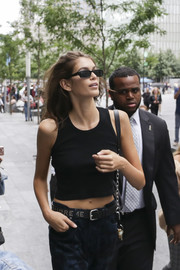 Kaia Gerber teamed her pants with a studded black belt by Supreme for New York Fashion Week.