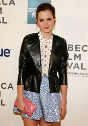 Emma Watson's leather blazer toughened up this girly print ensemble at the premiere of 'Struck by Lightning.'