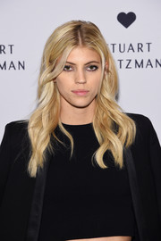 Devon Windsor showed off perfectly styled waves at the launch of the Stuart Weitzman Gigi boot.