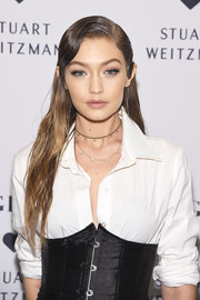 Gigi Hadid rocked a long side-parted wet-look style at the launch of the Stuart Weitzman Gigi boot.