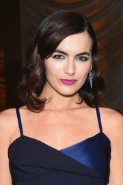 Camilla Belle's hot-pink lipstick made a beautiful contrast to her dark blue dress.