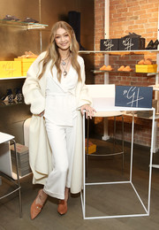 Gigi Hadid styled her look with a pair of coral suede mules from her collection with Stuart Weitzman.