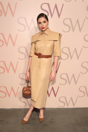 Olivia Culpo looked effortlessly chic in a structured leather shirtdress by Fendi at the Stuart Weitzman Spring celebration.