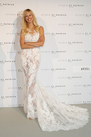 Karolina Kurkova looked breathtaking in this lacy wedding gown with a long train at the Studio St. Patrick fitting.