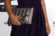 Natalie Portman showed off her quilted Delices clutch while hitting the Venice Film Festival.