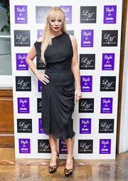 Liz Mcclarnon attended Style for Stroke looking chic in a corset LBD with a gathered skirt.